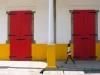 Haitian Boy & Red Doors